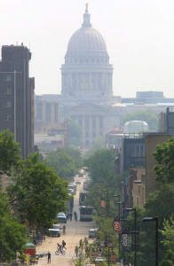 The state Capitol is enshrouded in haze July 7 as lingering smoke plumes from wildfires in Canada continue to move through the area. Photo Credit:  John Hart, Wisconsin State Journal