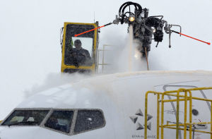 Crews work to de-ice a plane at O'Hare International Airport in Chicago on Feb. 1, when a snowstorm forced the cancellation of about 2,000 flights in the Midwest, most of them at O'Hare. Ice on the wings can disrupt the lift of the plane causing it to lose altitude.