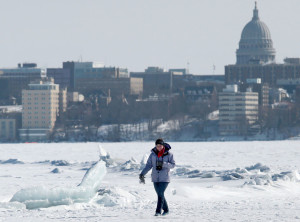 Kayla Powell of Lacrosse makes her way past a collection of ice heaves on Lake Mendota in February.   With this month's warm temperatures, it could be a while before the lake freezes again.  Photo credit:   John Hart, State Journal archives
