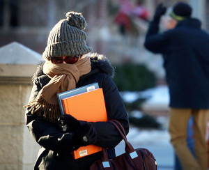 UW-Madison graduate student Marguerite Heckscher bundles against frigid cold temperatures as she makes her way across campus last month.  We might not be done with bitter cold for the winter, but we don't have much longer to go.  (Photo credit:  John Hart, State Journal)