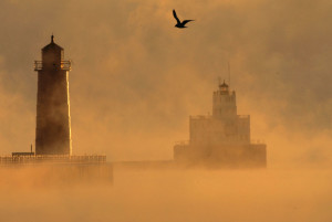 """Sea Smoke"" rises over the Milwaukee River where it meets Lake Michigan, in Milwaukee.  Sea smoke comes from the rapid addition of water vapor to the air when really cold, dry air moves over an open body of relatively warm liquid water. (Photo credit:  Jeffrey Phelps, Associated Press archives)"