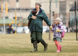Lesley Davidson, of Madison, shelters her 8-month-old daughter, Eleanor, from the wind as she walks with her 4-year-old daughter, Lily, to the Chazen Museum of Art on the UW-Madison campus on Wednesday. (Photo credit: Amber Arnold, State Journal)